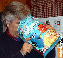 Photo: Mike inspects his box of Finding Nemo.