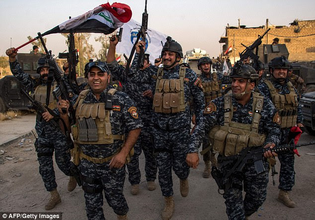 Lat week, ISIS allegedly admitted al-Baghdadi has been killed dead, according to reports in Iraq. Pictured: Iraqi soldiers celebrate the liberation of Mosul