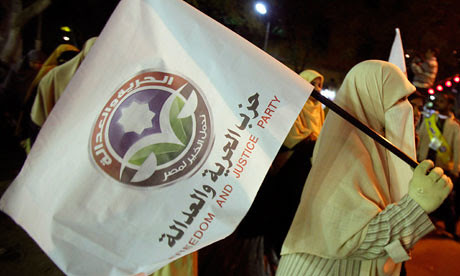 A demonstrator carries the flag of the Muslim Brotherhood in the North African state of Egypt. The Brotherhood may seek the presidency in the upcoming national poll. by Pan-African News Wire File Photos