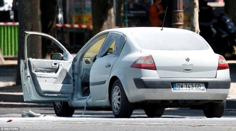A witness in the capital said he heard shots being fired and smoke coming from one of the vehicles, thought to be this Renault Megane