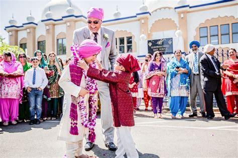 Milni between two boys outside Gurdwara   Indian Wedding