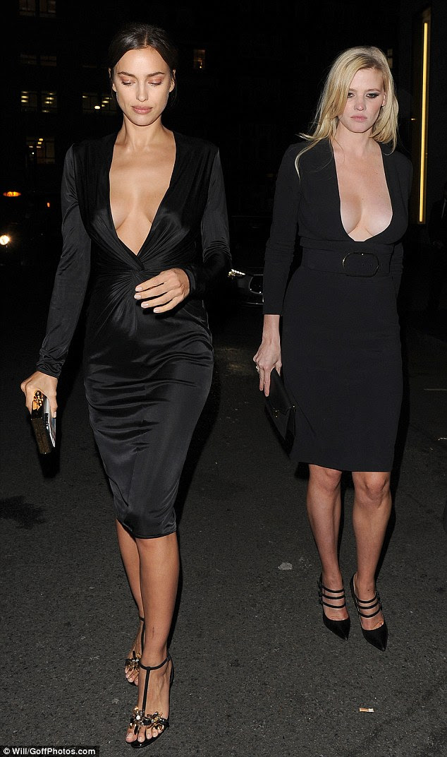 Busty in black: Models Irina Shayk (L) and Lara Stone (R) were on hand to helpEnninful celebrate his OBE on Thursday evening