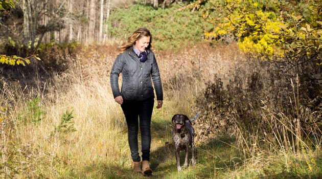 Tove Fall walking with her dog.