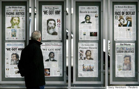 saddam hussein newspapers