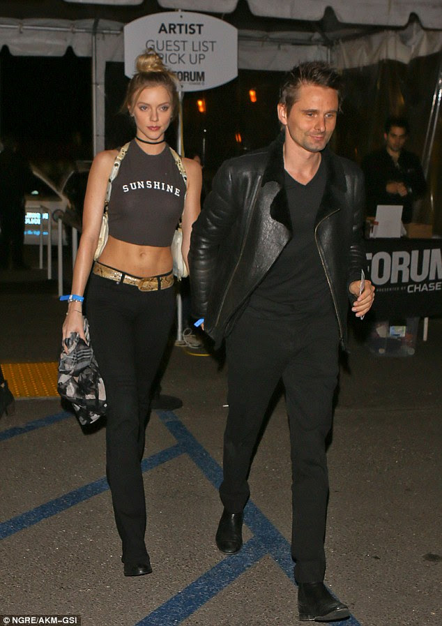 Happy together: Model Elle Evans looked perfectly loved up as she held hands with Muse frontman, Matt Bellamy at The Weeknd concert at The Forum in Inglewood on Tuesday evening