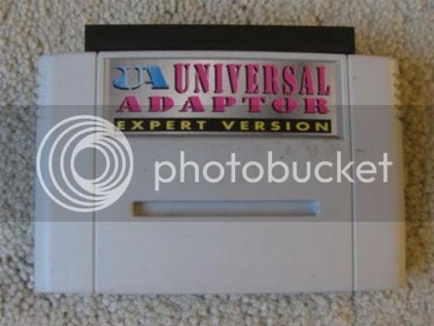 http://i236.photobucket.com/albums/ff289/diegoshark/blogsnes/Super-Nintendo-Snes-Universal-Adapter-1041428_480x360.png