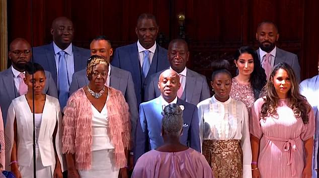 The gospel choir sang 'Stand By Me' and 'This Little Light of Mine' during the ceremony