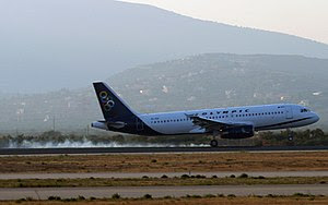 SX-OAI of Olympic Airways seen here landing at...