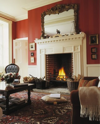 Oriental Rug in a classicly decorated house with fireplace and mirror