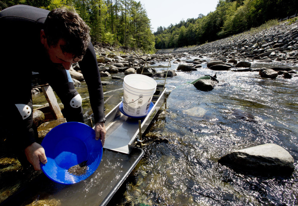 Chris Hall uses a sluice box to pan for gold Sept. 4 in the Wild Ammonoosuc River in Bath, N.H. A new generation of gold miners is giving prospecting a try, especially in New England and the Pacific Northwest.
