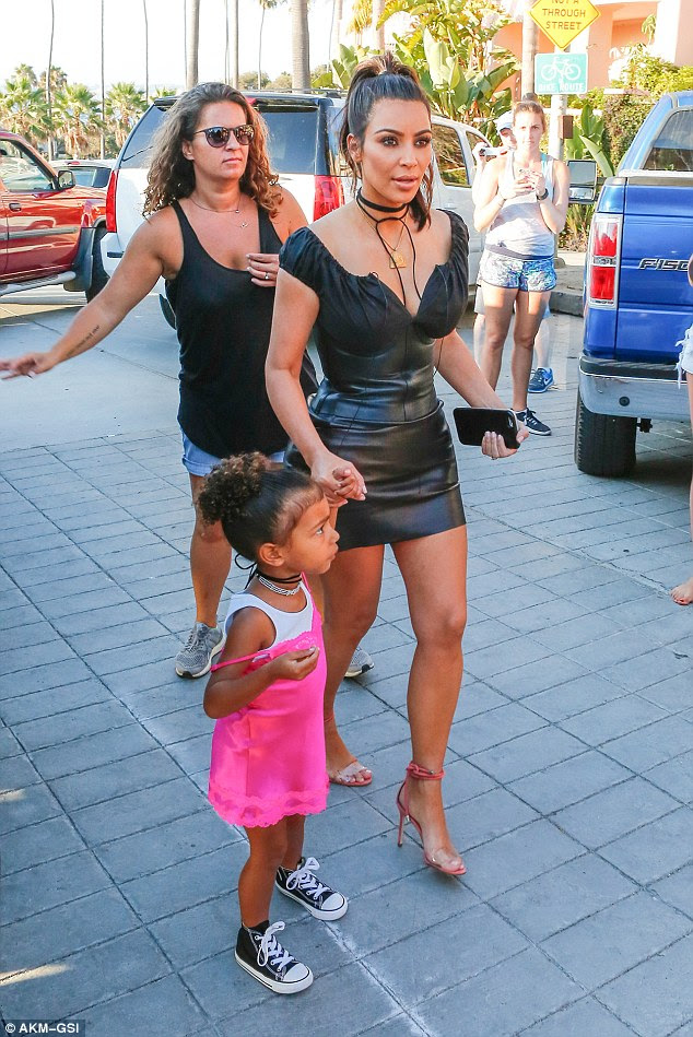 Taped for KUWTK: The reality star added a pair of nude  heels with pink ties and soles and wore a black choker and gold pyramid pendant as she arrived at the video-taped gathering with three-year-old daughter North