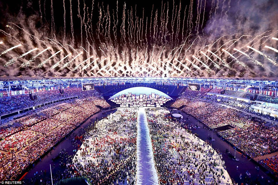 Fireworks explode at the culmination of the opening ceremony on Friday night - officially kicking off the Games