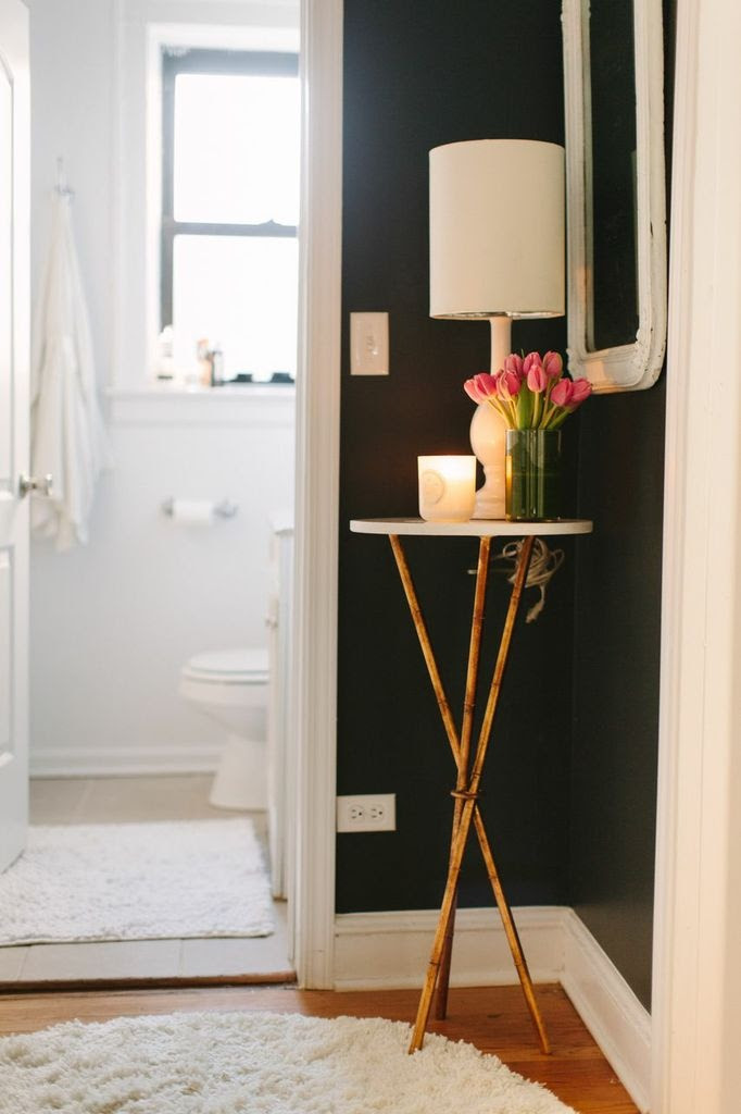 @Danielle Lampert Lampert Moss Chicago Home Tour // hallway // dark paint // Lulu & Georgia table and lamp // photography by Stoffer Photography