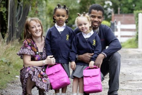 All grown up: Mother Amanda Biggs, twins Millie and Marcia and father