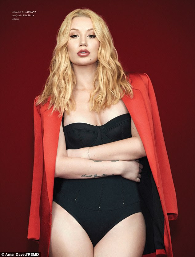 High end: The blonde beauty wears a Dolce & Gabbana corset bodysuit and a chic red Balmain jacket in another stunning shot