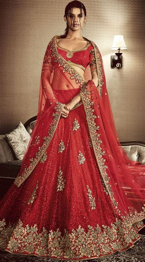 Attracts Million Heavy Embroidered Red Net Bridal Lehenga