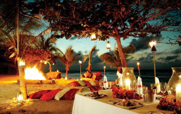 formal dining on the beach with bonfire and lantern light