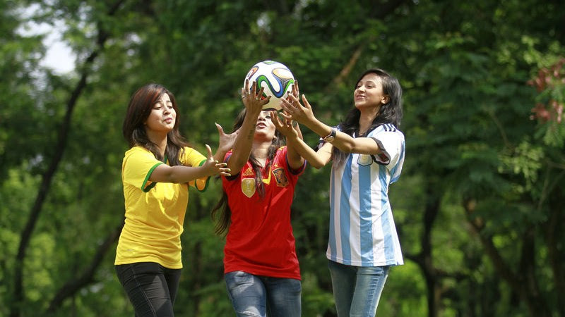 A group of football fans in Dhaka seen wearing their favorite team jerseys ahead of the upcoming 2014 FIFA World Cup in Brazil.