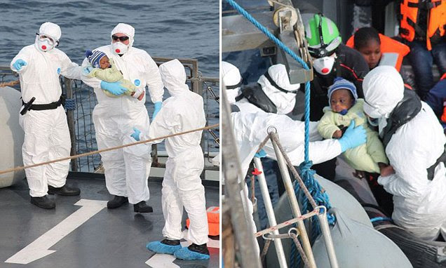 Heart-warming moment tiny baby is rescued by Irish sailors from boat packed with hundreds