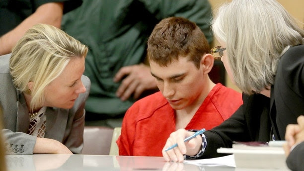 Nikolas Cruz, facing 17 charges of premeditated murder in the mass shooting at Marjory Stoneman Douglas High School in Parkland, appears in court for a status hearing in Fort Lauderdale, Florida, U.S. February 19, 2018.   REUTERS/Mike Stocker/Pool     TPX IMAGES OF THE DAY - RC11AA31B370