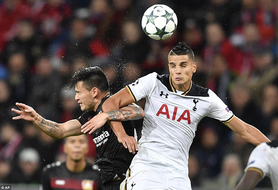 Lamela bravely beats fellow South American Charles Aranguiz to the ball in the air as the duo do battle in Germany