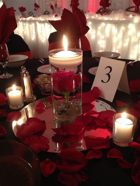 Lukas Wedding. Red Rose Centerpiece with floating candle