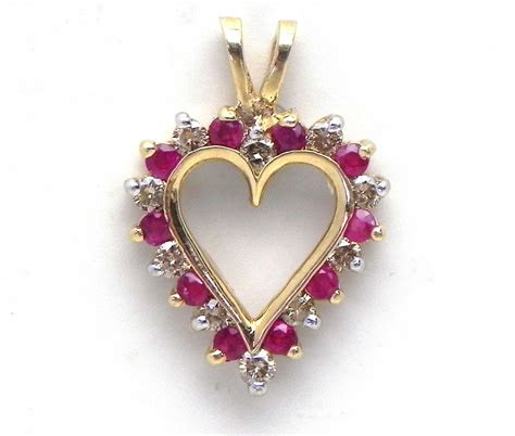 ladies yellow gold diamond ruby open heart pendant