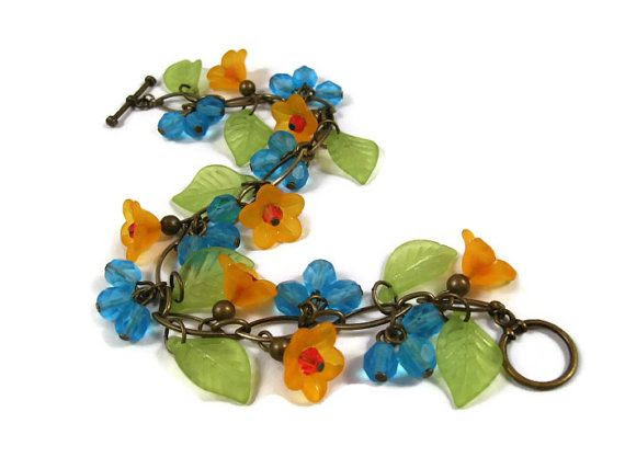 Flower Charm Bracelet Orange Blossoms Colorful by justCHARMING, $26.00 https://www.etsy.com/listing/88856122/flower-charm-bracelet-orange-blossoms
