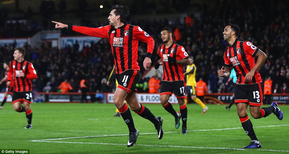 Daniels pictured running away in celebration with his Bournemouth team-mates after scoring against Arsenal