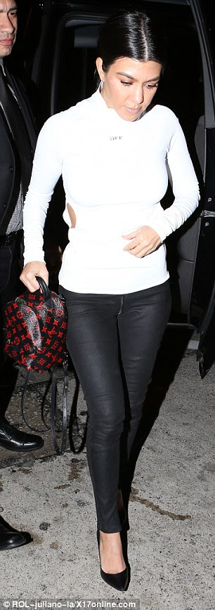 Hell for leather: Petite Kourtney decided to wear a pair of fitted leather trousers and a white polo neck top