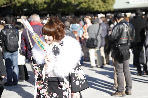 Girl in kimono holding a Hamaya