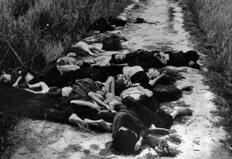 Description of  Bodies lay in the road leading from the village of My Lai, South Vietnam, following the massacre of civilians on March 16,1968. Within four hours, 504 men, women and children were killed in the My Lai hamlets in one of the U.S. military's blackest days. (AP photo/FILE/Ronald L. Haeberle, Life Magazine)
