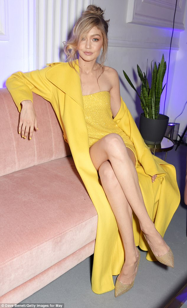 Sitting pretty: The catwalk star looked like the perfect muse for her Maybelline range as she reclined on a pink chaise-longue inside the bash