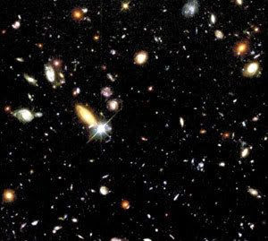 Scores of galaxies grace this photo of the Hubble Deep Field...one of the most popular images taken by the space telescope.
