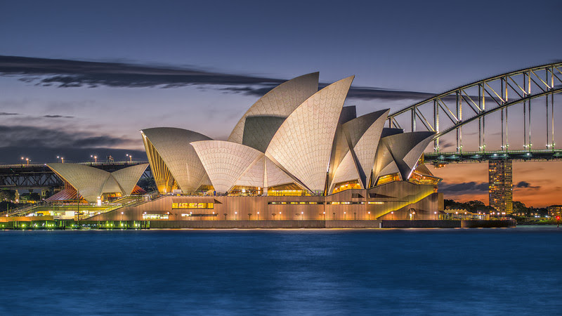 Sydney Opera House by night from Farm Cove