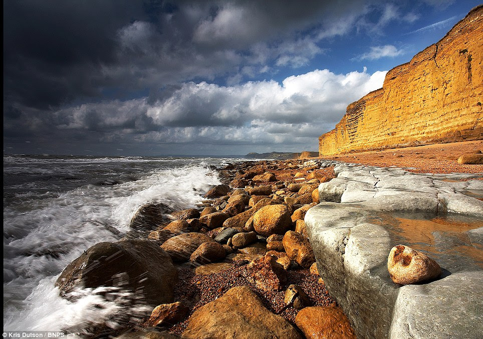 Storm clouds gather: Rain approaching the cliffs at Burton Bradstock in south west Dorset. Patient Kris often waits for hours before taking a photograph
