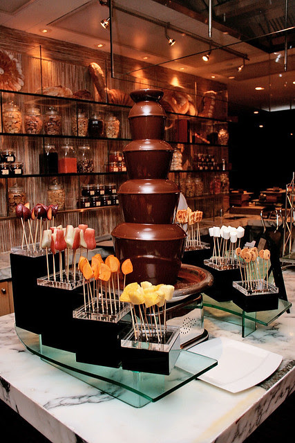 Chocolate tower next to the waffle and ice cream station