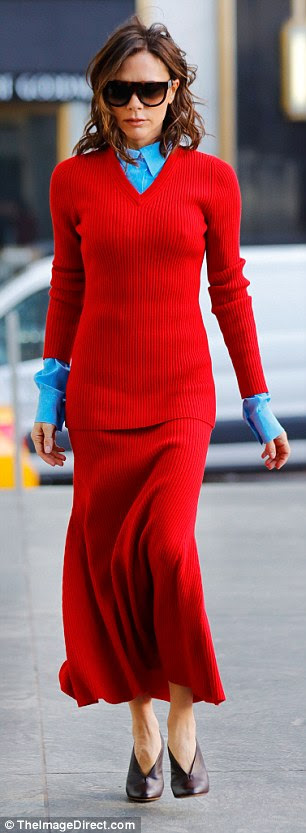 Turning heads: Hours earlier she chose a bold red ribbed knit dress, coordinated with a crisp blue shirt, to make her first appearance while in the Big Apple