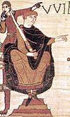 พระสาทิสลักษณ์บนพรมแขวนผนังของสมเด็จพระเจ้าวิลเลียมที่ 1 ผู้พิชิตขณะทรงรบในสมรภูมิเฮสต์ติง ที่เมืองบาโยซ์ ประเทศฝรั่งเศส