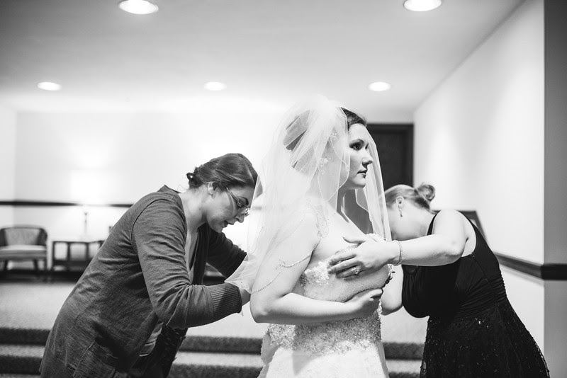 Photos of the bride and her bridesmaids getting ready in the basement at Court Street United Methodist Church in downtown Rockford Illinois for an Autumn wedding.