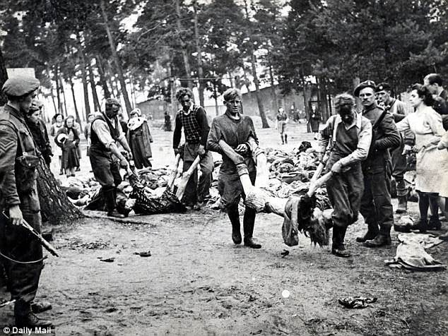 Aftermath: During the liberation of Belsen in April 1945. S.S. guards were forced to remove the bodies of their victims into lorries on their way to be buried