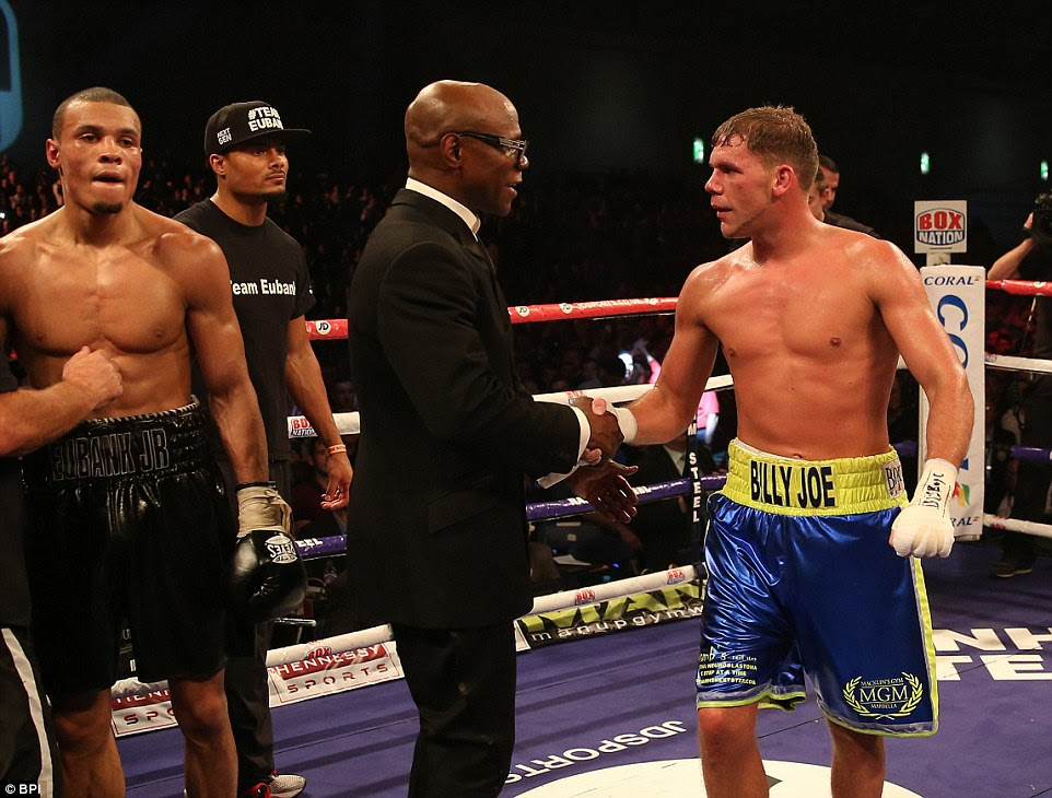 Chris Eubank (centre) congratulates Saunders on his victory against his son by shaking his hand after the final bell