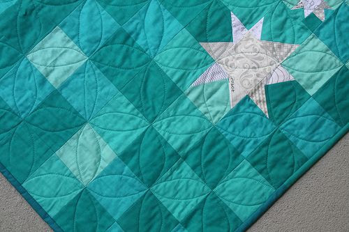 Love the different teals in this quilt with the white stars