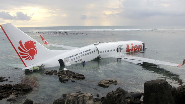 PHOTO:In this photo released by Indonesian Police, the wreckage of a crashed Lion Air plane sits on the water near the airport in Bali, Indonesia on Saturday, April 13, 2013.