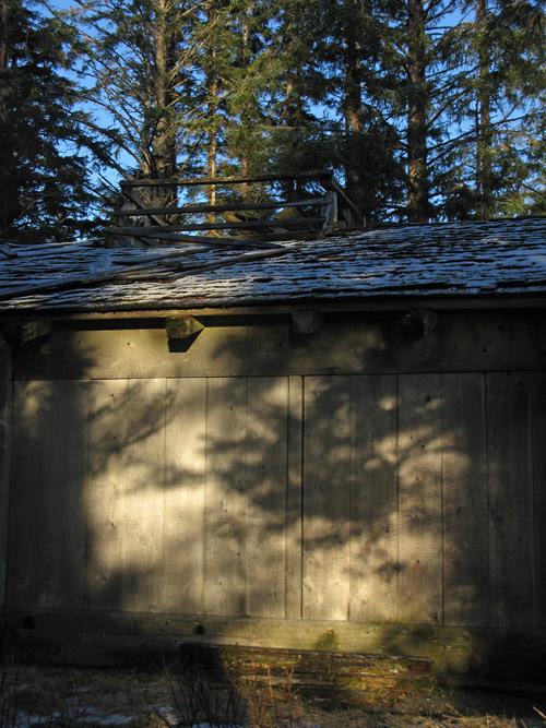 shadow on Naay I'waans, Chief Son-i-Hat Whale House, Kasaan, Alaska
