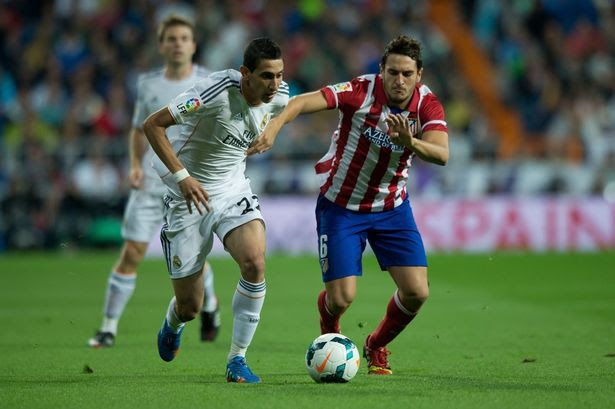 Man united target: Koke (R) of Atletico Madrid is on Moyes' radar