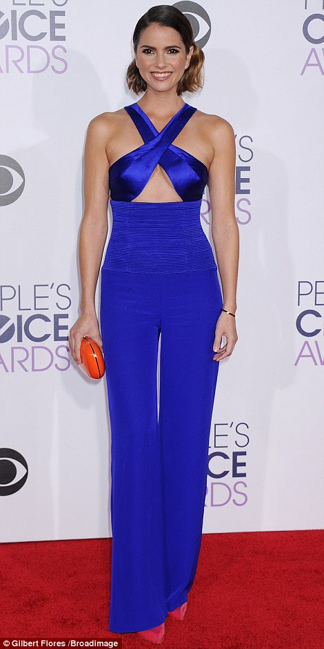 Peekaboo: While Maggie Lawson (L) flashed a little leg, Shelley Hennig showed some underboob in a cobalt blueGomez-Gracia jumpsuit