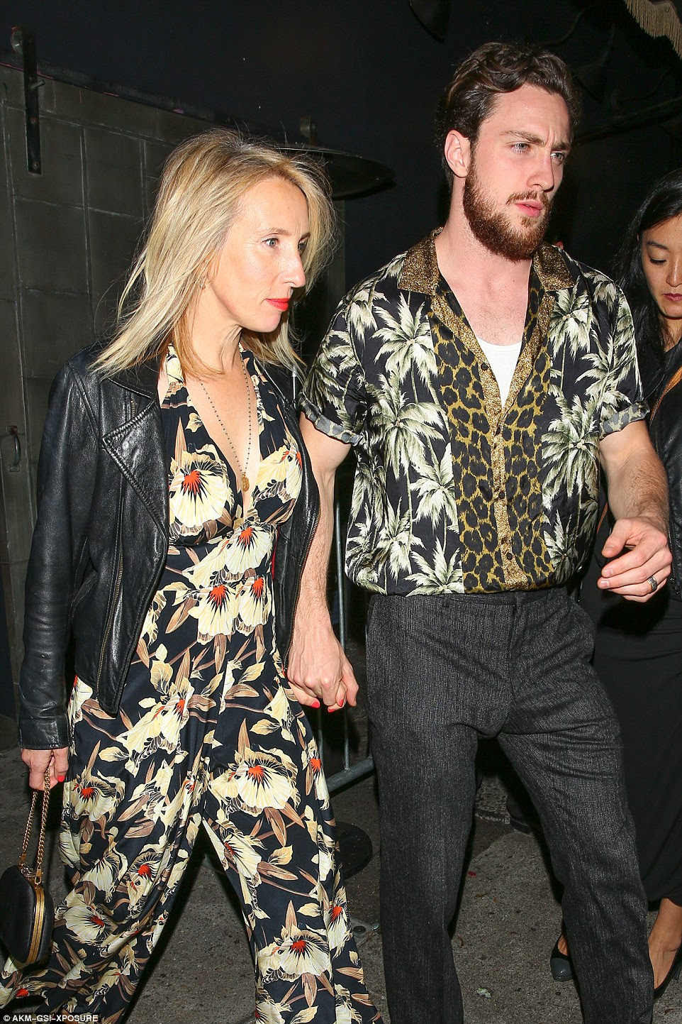 Quite a sight: Aaron Taylor-Johnson and Sam Taylor-Johnson certainly turned heads as they showed up in very daring prints
