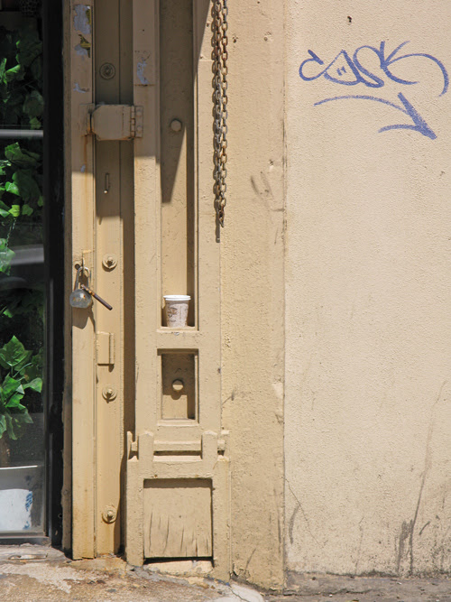 a composition with an entrance, a cup, and graffiti, Manhattan, NYC