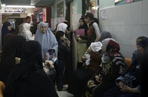 Working class Egyptians queue for check-ups at an Islamic …